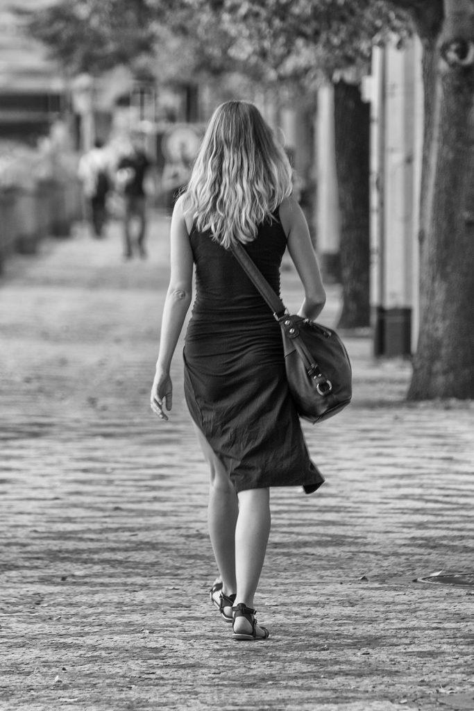 minimalist street photo walking woman